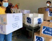 चीनी वायरस के खिलाफ जंग – विदेश में भी लोगों की सहायता में जुटे स्वयंसेवक